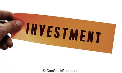 Cutting Investment Concept - Cutting a bright orange piece...