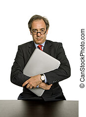 executive - mature business man with his laptop, isolated on...