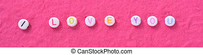 i love you text on pink paper