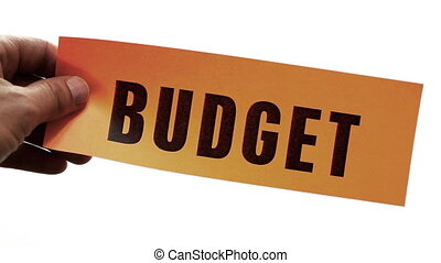 Budget Cuts Business Concept - Cutting a bright orange piece...