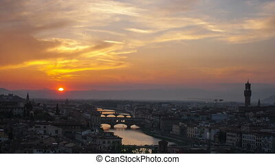 Sunset over bridges through the river Arno in Florence,...