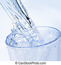 Water is poured into a glass - Detail of drinking water that...