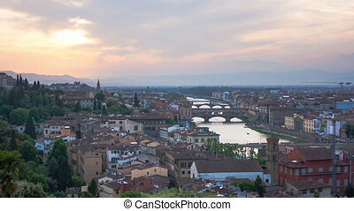 View of Gold Ponte Vecchio Bridge in Florence on a sunset,...