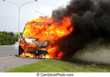 Car Burning with Fire - Delivery vehicle burning on the side...