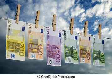 Euro bills on a clothesline - Euro bills hanging on a...