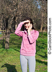 Happy smiling girl talking over the phone - Funny pretty...