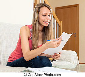 girl freelancer working with documents - Successful girl...