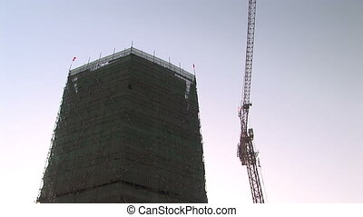 Building Under Construction - Crane and bamboo scaffolding...