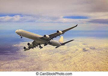 passenger jet  plane flying over cloud