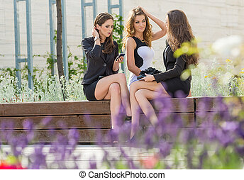 Successful businesswomen in the city on a bench