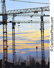 crane of building construction against beautiful dusky sky use for construction industry business and land development