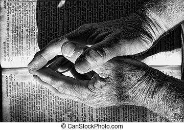 Forgiveness - Male hands on bible