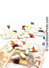 Pile of pills and banknotes closeup with copy-space