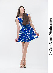 Woman standing in blue dress - Emotional attractive young...