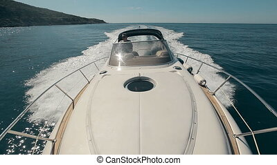 Man drives the yacht - Mature man drives the yacht among...