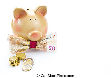 Piggy bank with a banknote bow and coins isolated with copy-space