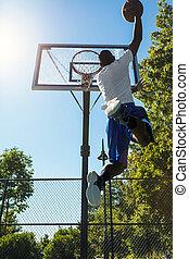 Basketball Monster Jam - Young basketball player drives to...