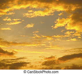 Golden clouds background - Light from setting sun colored...