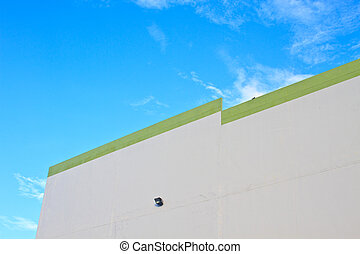 Building concrete wall with blue sky