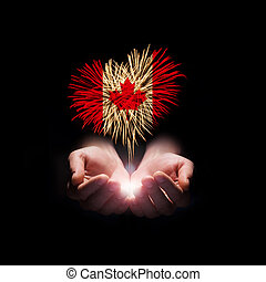 Canada day. Welcome to Canada - Fireworks in male hands in a...