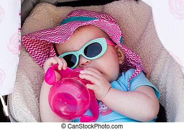 Baby girl - Cute baby girl sucking on her water bottle.