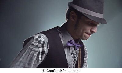 Stylish Performer - Tilt of young guitarist rocking against...