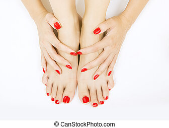 red manicure and pedicure - female foots with red pedicure...