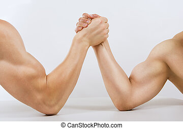 Two muscular hands clasped arm wrestling