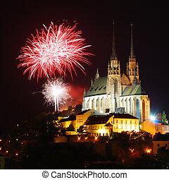 Gothic medieval cathedral with fireworks above