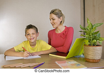 Woman helping her son with homework