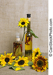 aromatic olive oil with herbs and spices with sunflowers