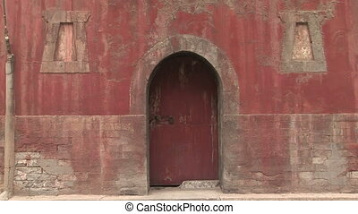 Doorway at Buddhist Temple - Red wall and door of Buddhist...