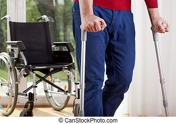 Disabled man on crutches - Horizontal view of a disabled man...