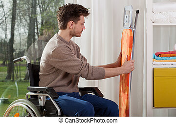 Disabled man before ironing