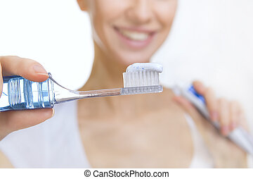 Closeup girl with toothbrush cleaning teeth at home, dental...