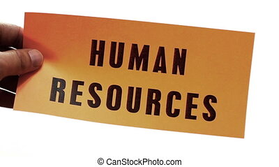 Cutting Human Resources Concept - Cutting a bright orange...