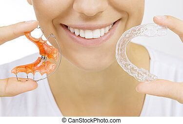 hands holding retainer for teeth and tooth tray - Beautiful...