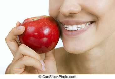 smiling girl with retainer for teeth and apple - Beautiful...