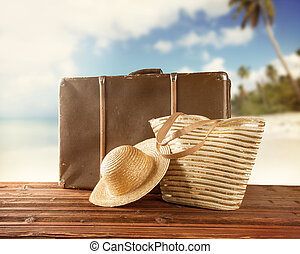 Old suitcase with accessories on beach - Concept of summer...