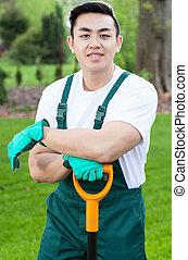 Asian gardener during work - Vertical view of an asian...