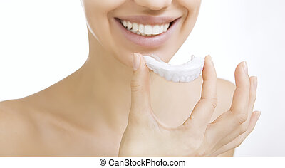smiling girl with tooth tray - Beautiful smiling girl with...