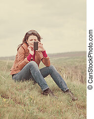 Woman using her mobile phone outdoors
