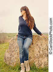 Middle-aged woman thinking outdoors - Attractive casual...