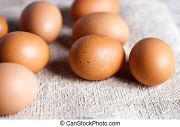 fresh brown eggs on linen background