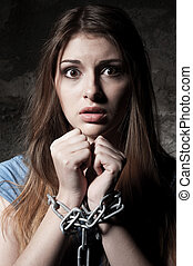 Trapped woman. Shocked young woman looking at camera while...