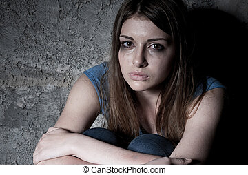 Hopelessness. Top view of young woman crying and looking at...