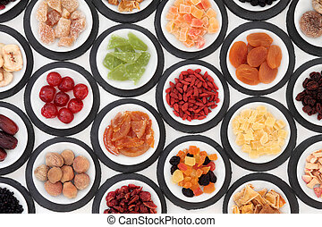 Healthy Fruit Snacks - Dried fruit selection in white bowls...