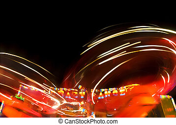 Amusement ride - Blur neon lights in amusement park, long...