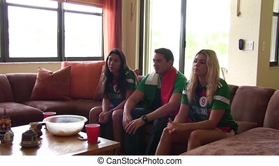 Group of happy Mexican soccer fans Goal Celebration