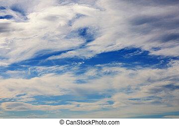 clouds in blue sky - lots of clouds in a blue sky
